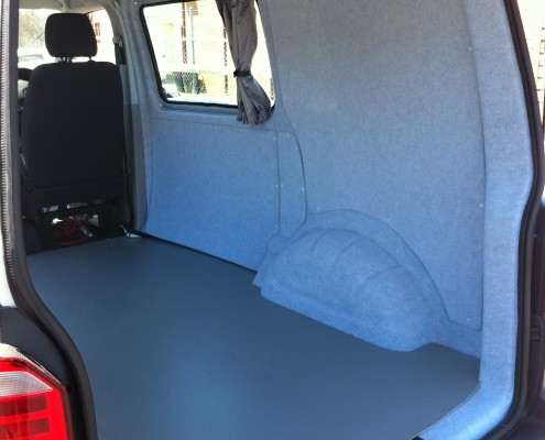 Campervan shell with insulated and carpeted interior
